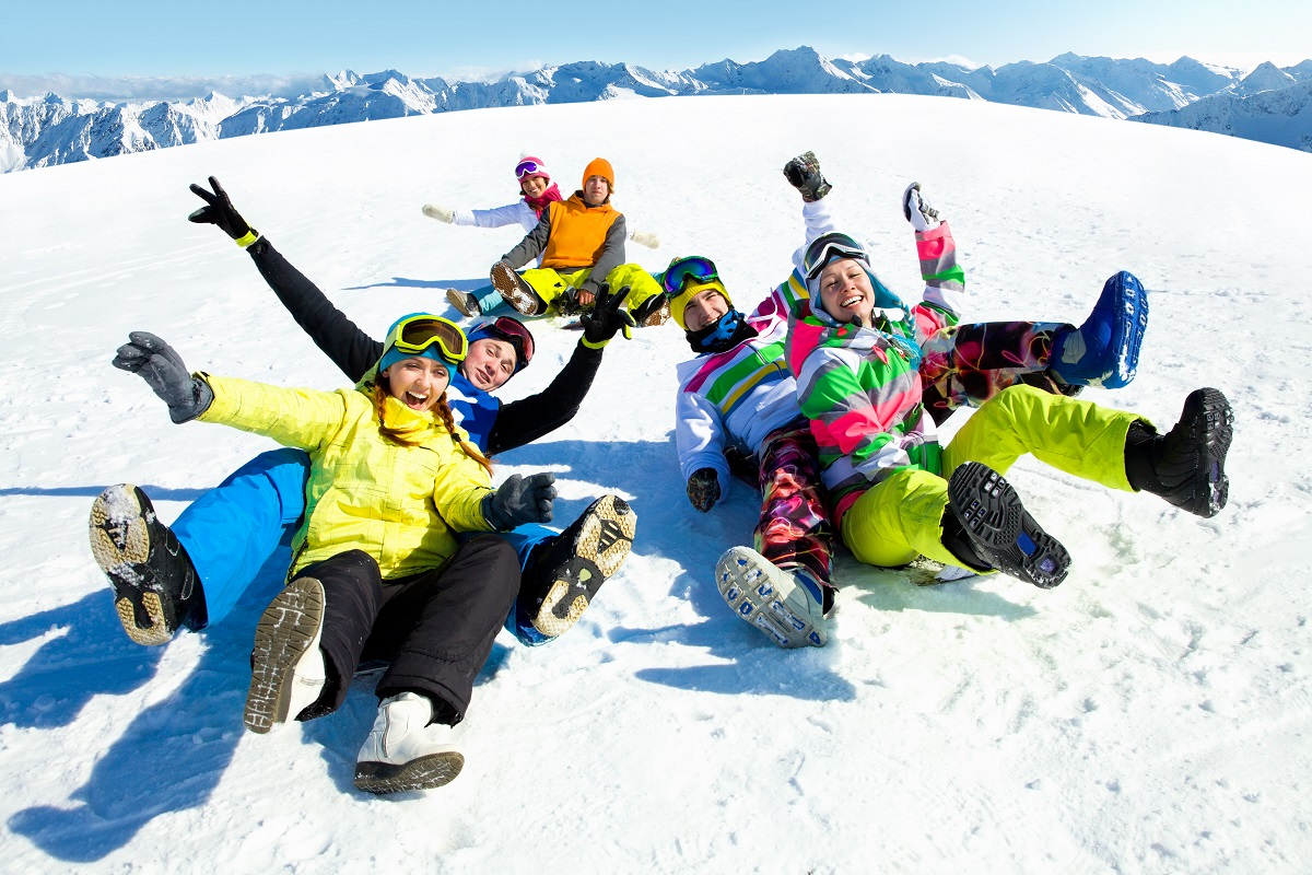 Friends lying on snow