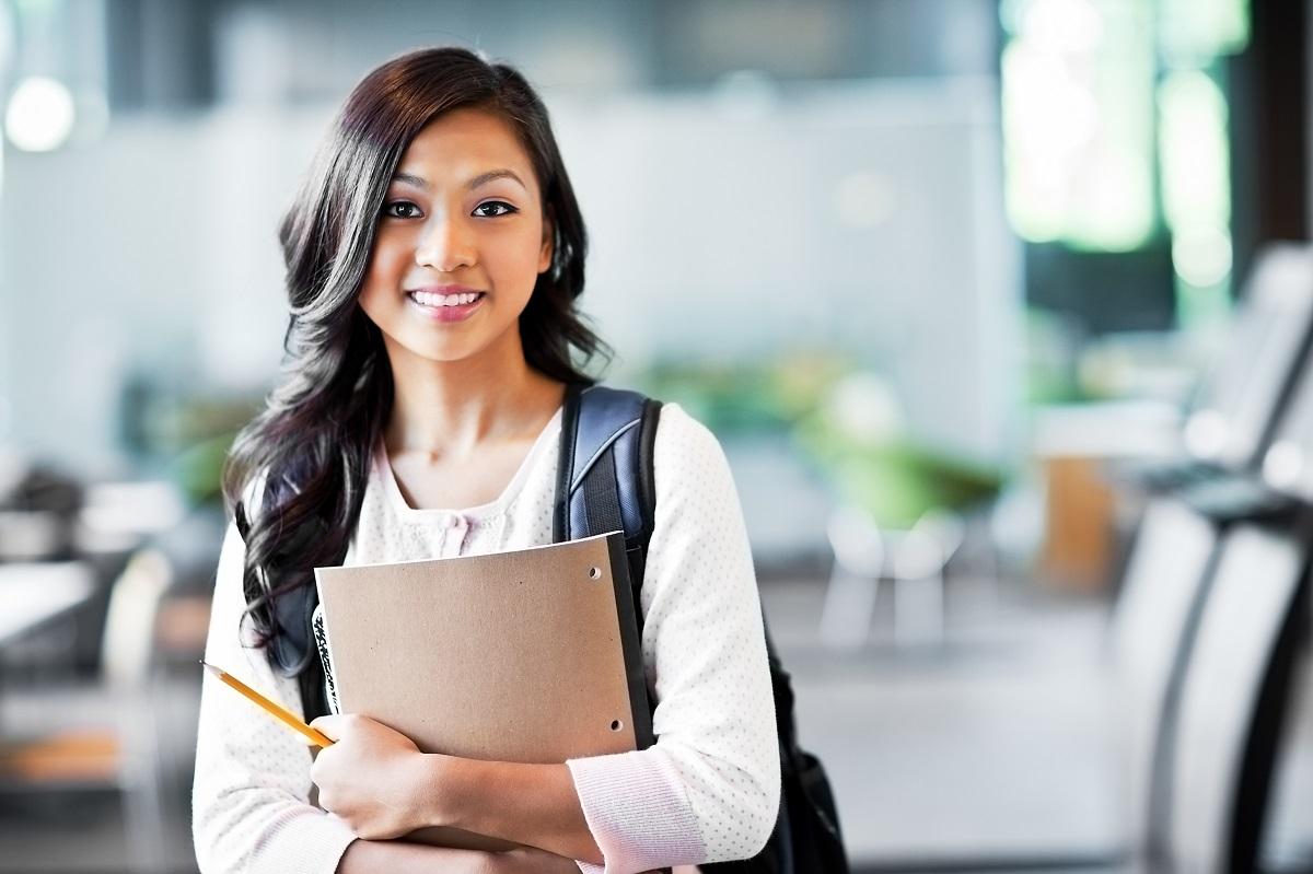 Student carrying her school stuff