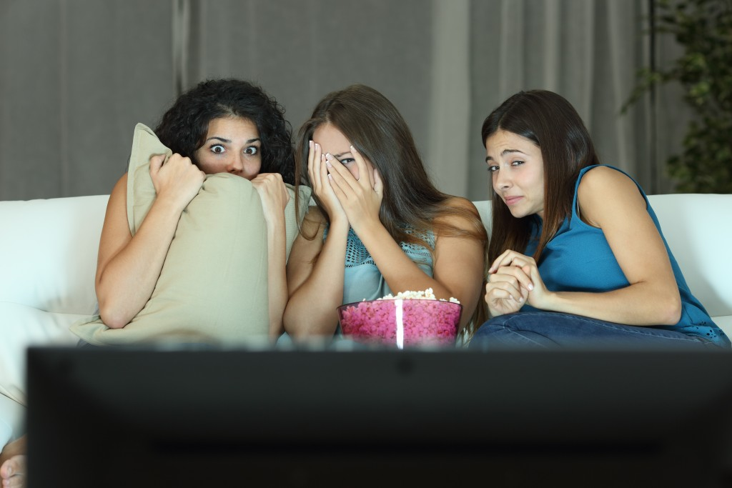 Girls watching a horror movie