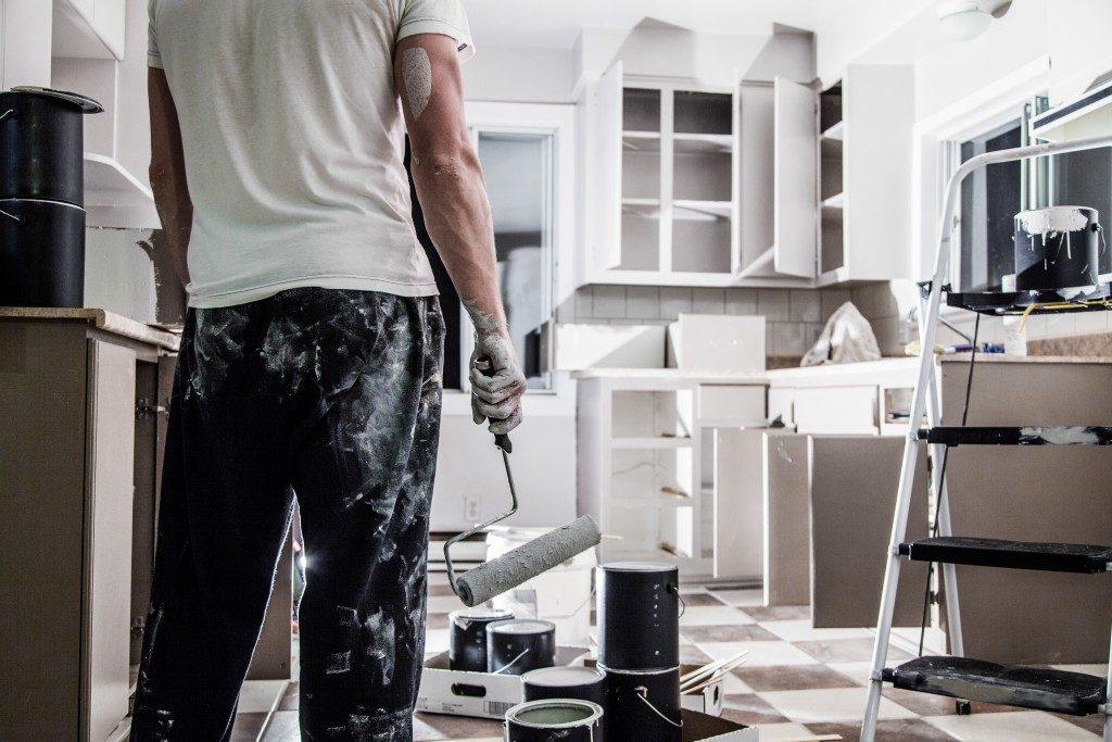 Man renovating house kitchen