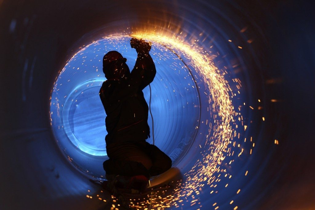 Worker welding inside a pipe