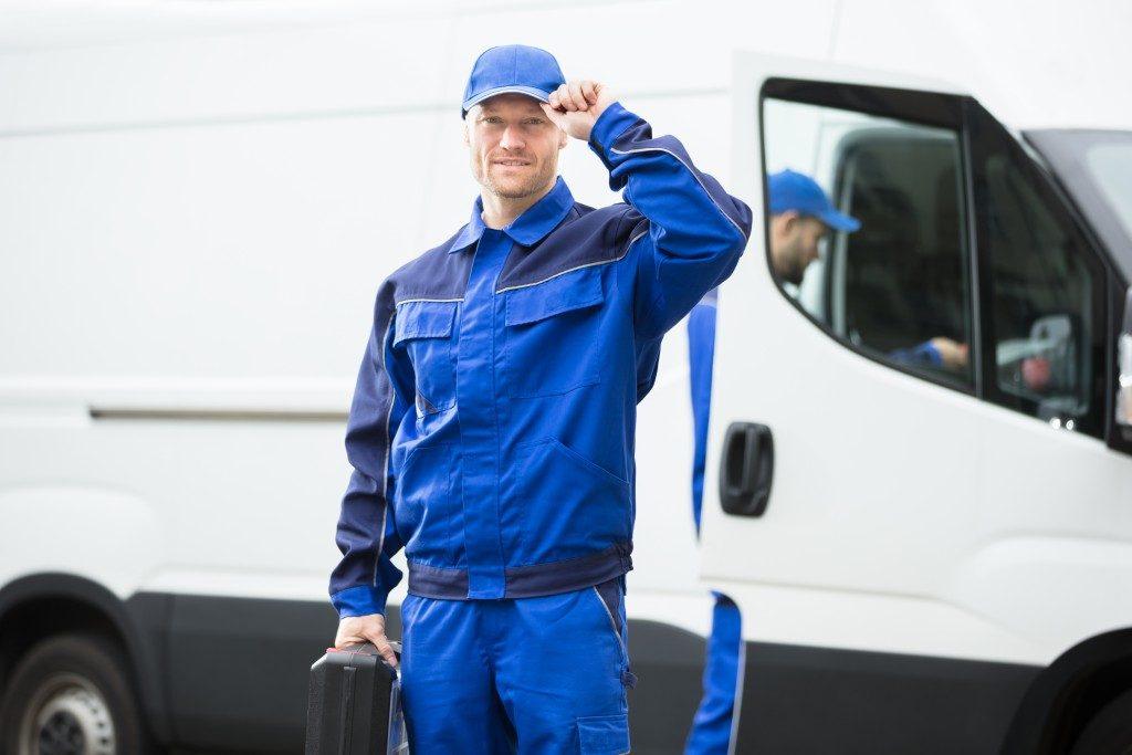 smiling technician wearing blue uniform