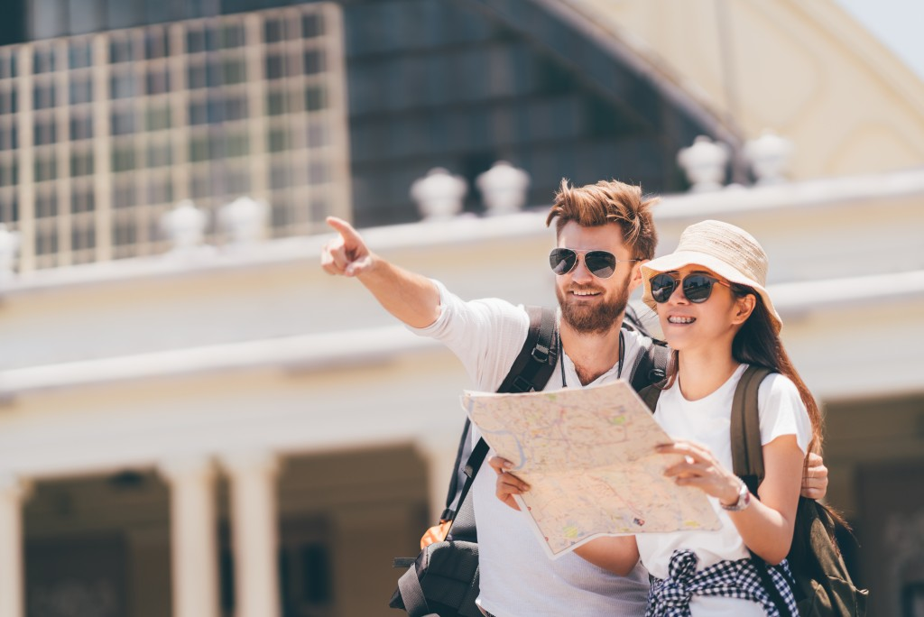 Tourist couple pointing at something