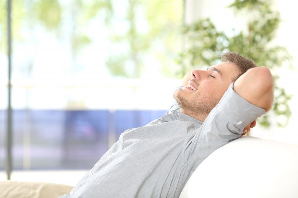 Man relaxing in the sofa