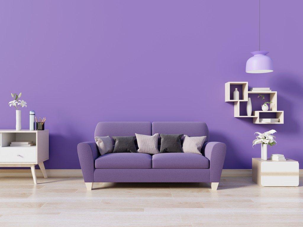 Purple sofa with purple wall
