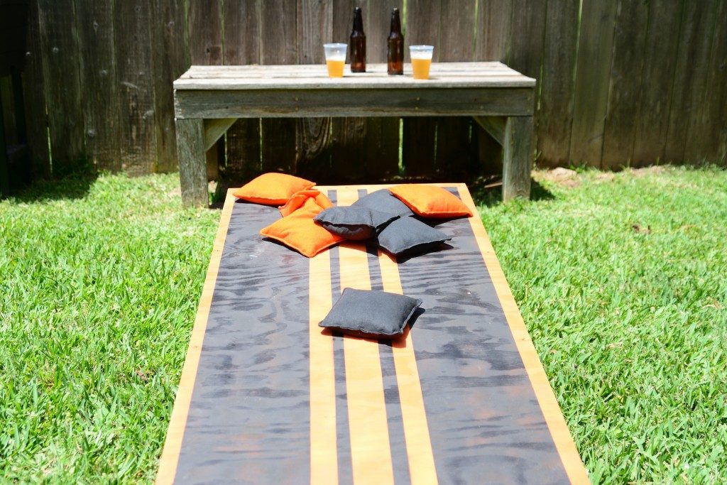 Cornhole lawn game with beer in the bakground