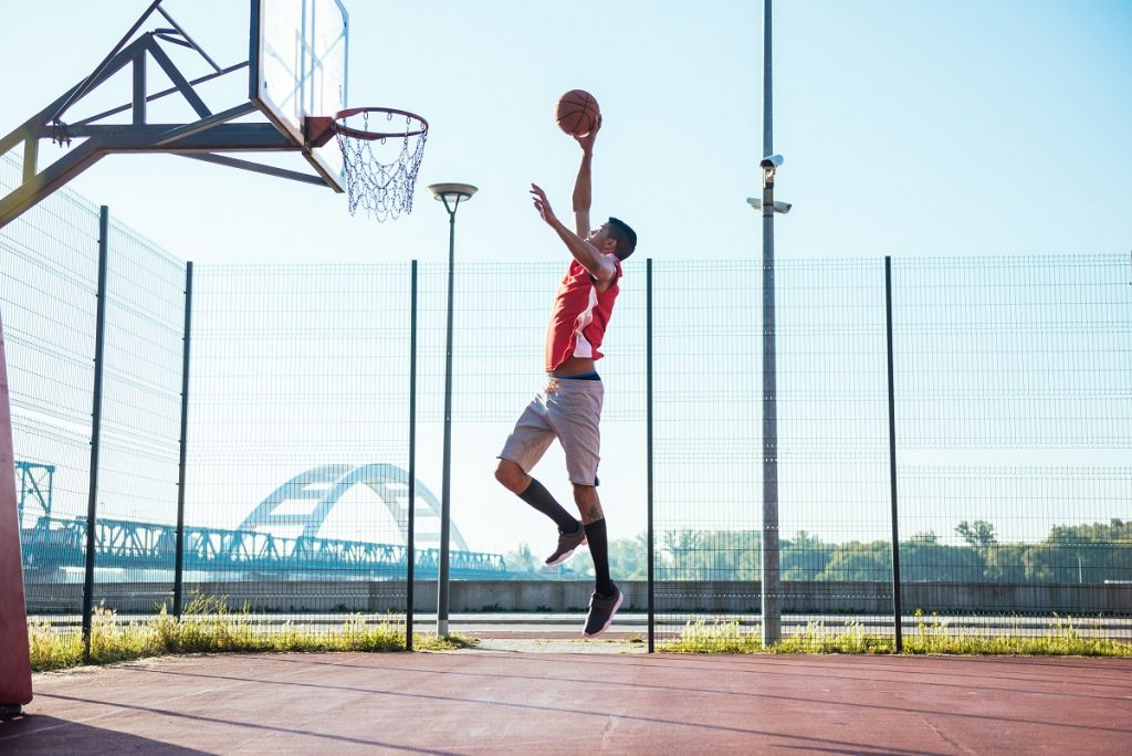Basketball player about to dunk