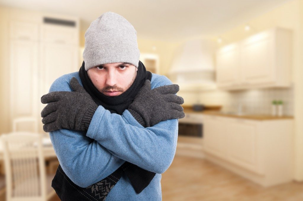 young male feeling cold and shivering