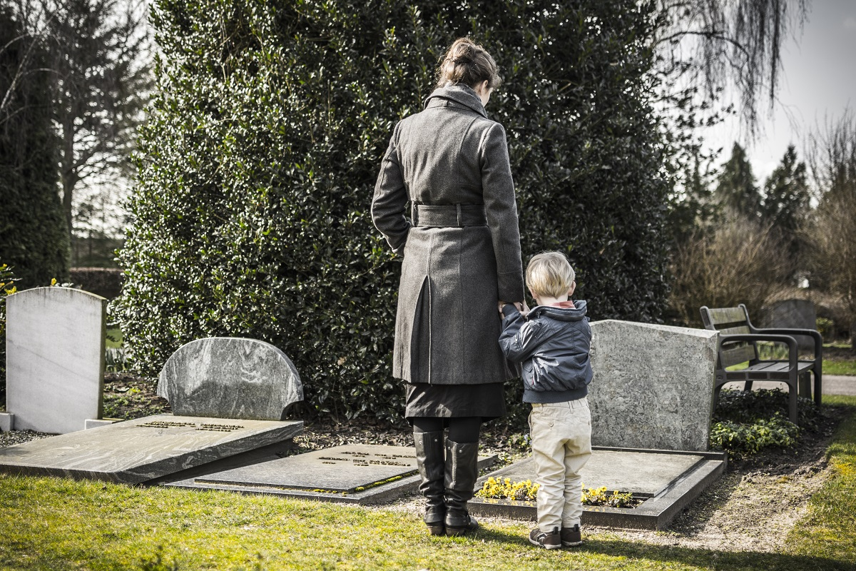 woman and her child at a graveyard