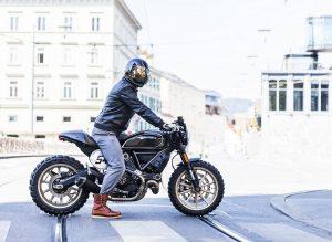 man in wearing black helmet, riding a motorcycle
