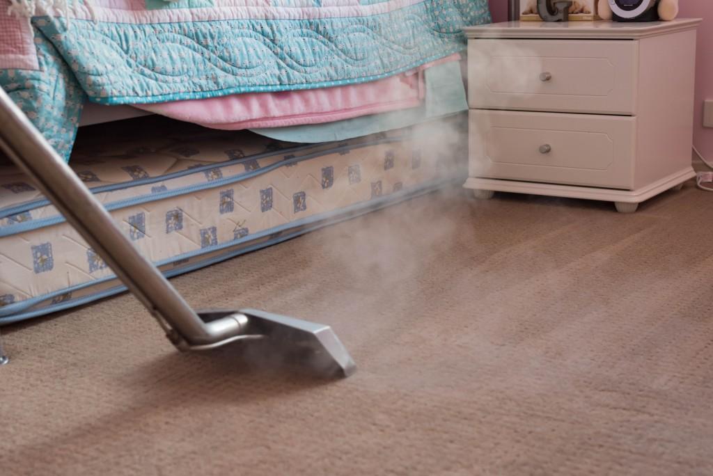 Vacuuming the floor of bedroom