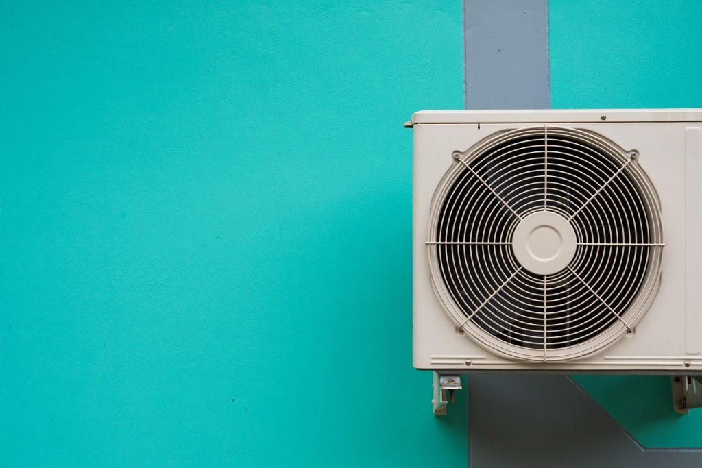 HVAC system over teal wall