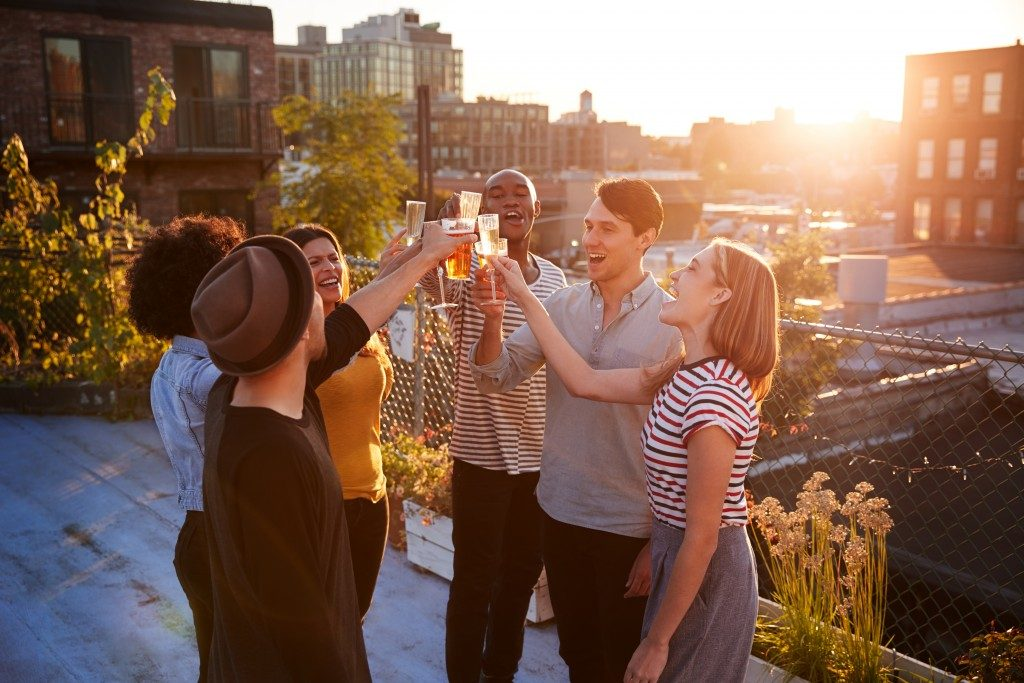 people celebrating at the rooftop