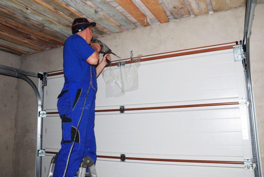 contractor installing garage door