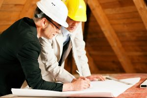two men looking at a constuction plan