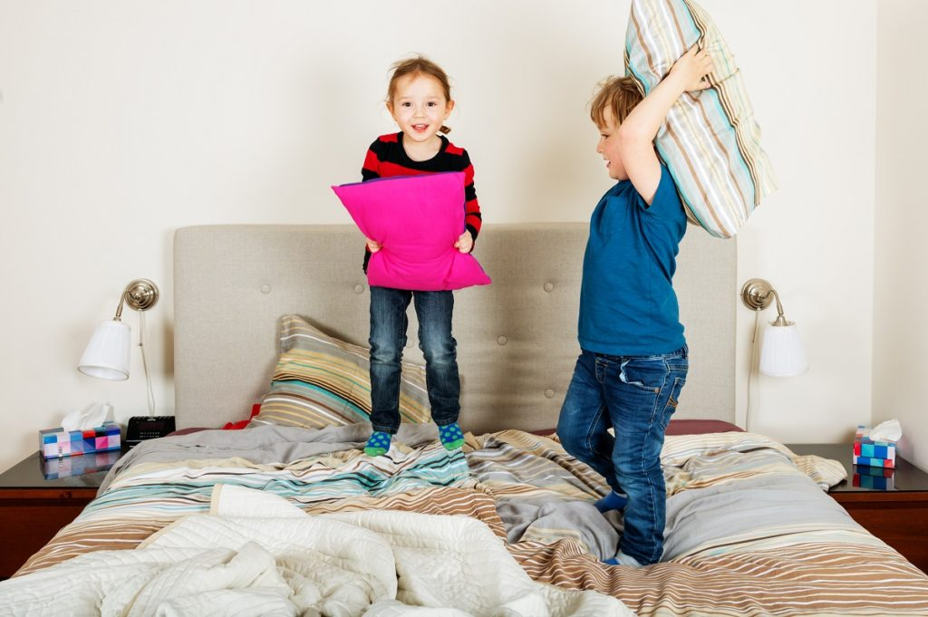 toddlers having a pillowfight