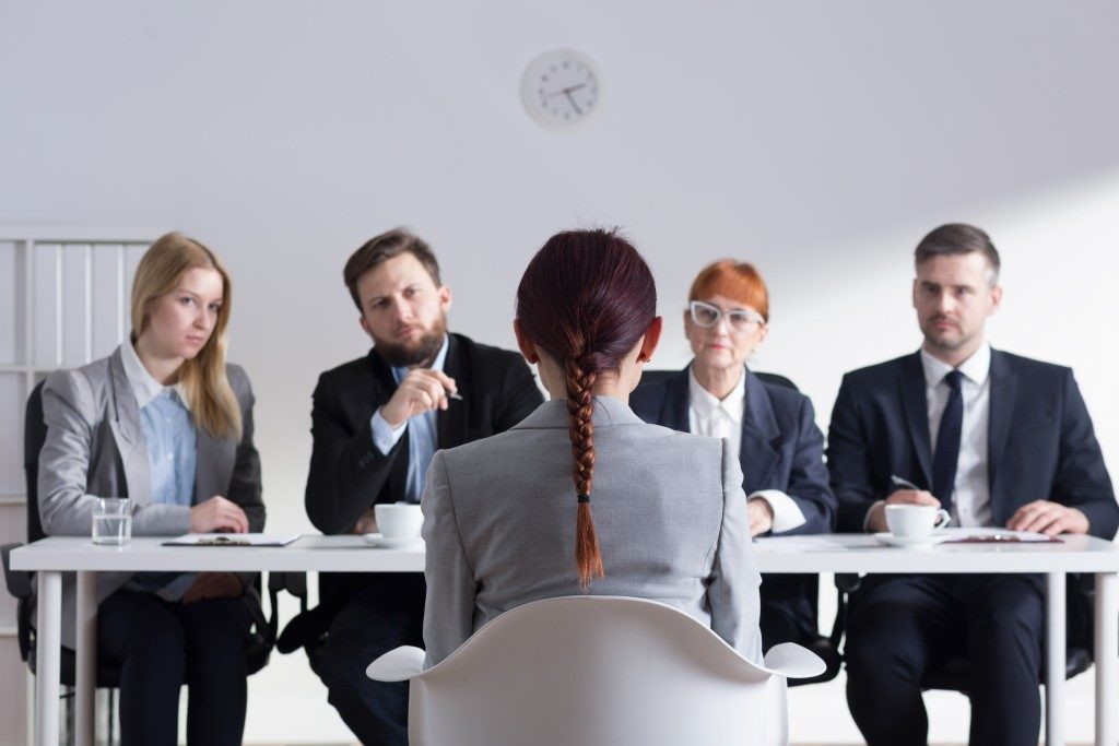 Applicant with interviewers