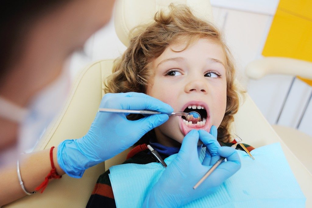 Kid in the dentist