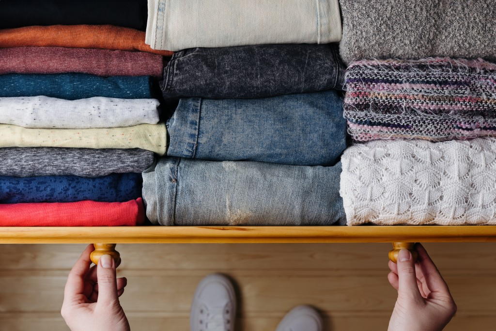 neatly folded clothes in drawer
