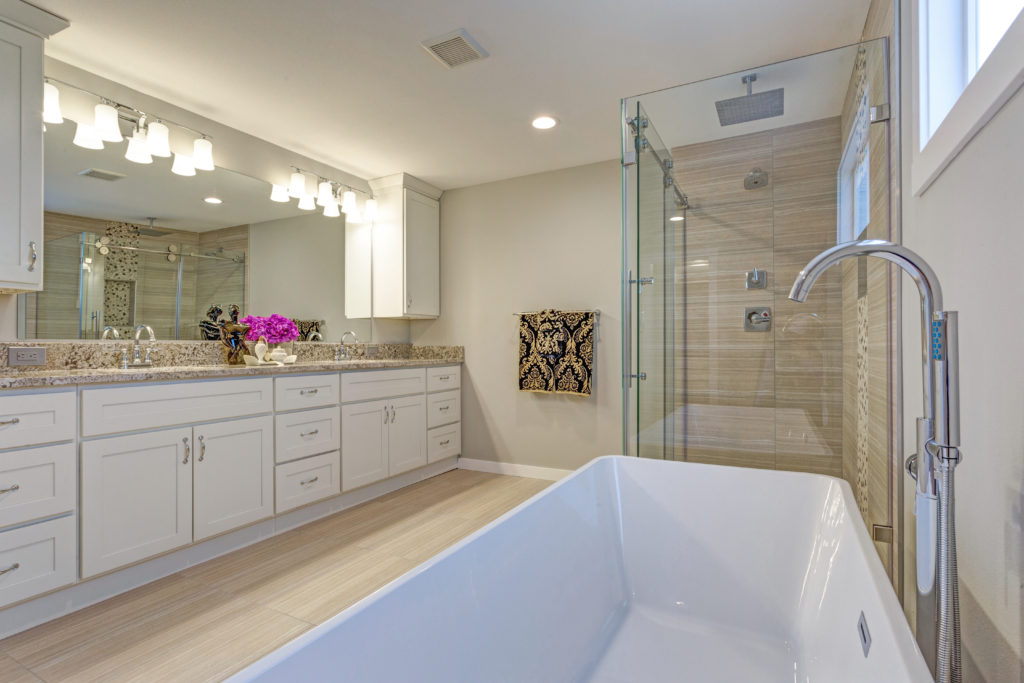 bathroom with bathtub and long cabinet