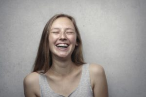 young woman with braces smiling