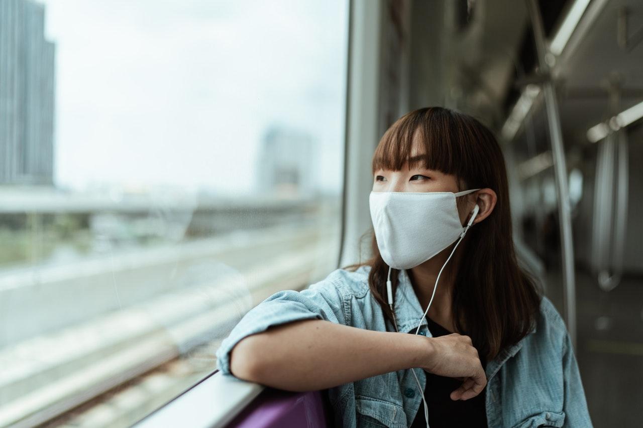 woman wearing mask public transportation